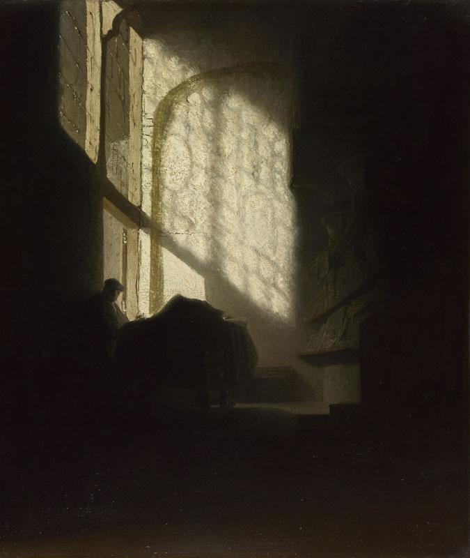 Follower of Rembrandt - A Man seated reading at a Table in a Lofty Room